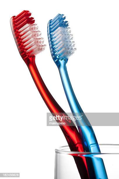 Toothbrushs en un vidrio