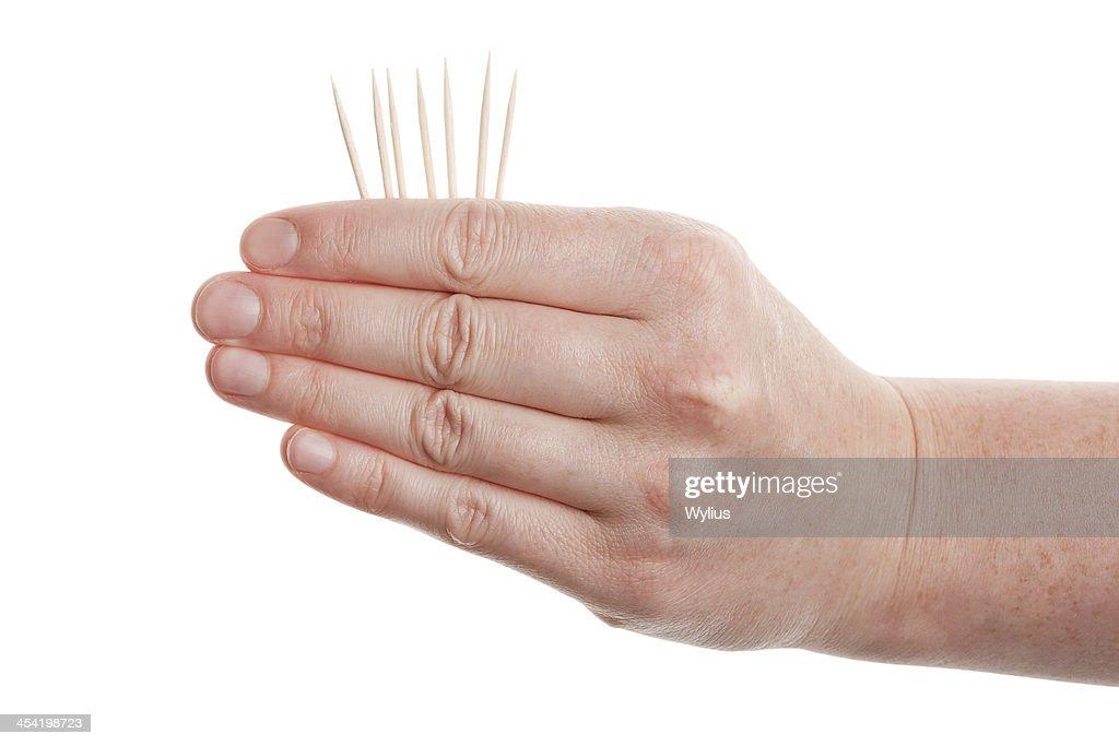 Toothpicks em mão : Foto de stock