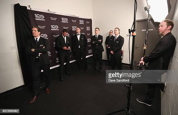 NHL Top 100 players Brendan Shanahan Mike Modano Eric Lindros Luc Robitaille Steve Yzerman and Joe Sakic wait with photographer Brian Babineau to...