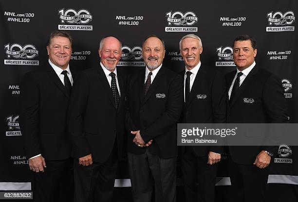 NHL Top 100 players Denis Potvin Billy Smith Bryan Trottier Mike Bossy and Pat LaFontaine pose for a portrait at the Microsoft Theater as part of the...