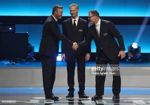 NHL Top 100 players Patrick Roy Dominik Hasek and Scott Stevens stand onstage during the NHL 100 presented by GEICO show as part of the 2017 NHL...