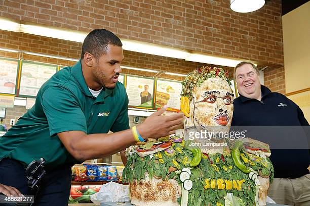 Top 2014 Draft Prospect Anthony Barr and Chief Marketing Officer for Subway Tony Pace attend Anthony Barr's Vegetable Statue Unveiling at Subway...
