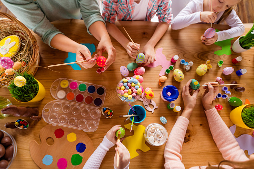 Top above high angle view of work place table nice group of people hands doing making decor accessory things classes courses studying in house indoors 1127982142