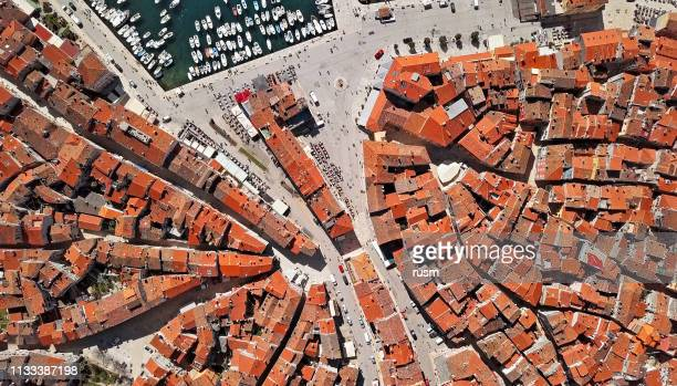 top aerial overhead view of old town rovinj. istria, croatia. - old town stock pictures, royalty-free photos & images
