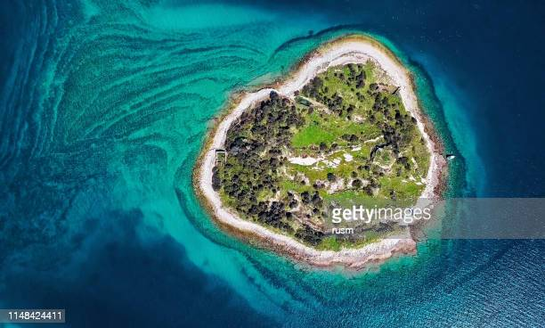 top aerial view of desert island, brijuni park, croatia - atoll stock pictures, royalty-free photos & images