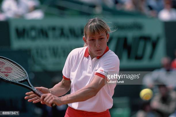 Top American tennis player Martina Navratilova prepares to hit a backhand slice during the 1983 French Open