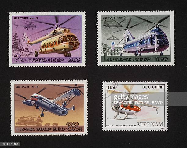 Top and bottom left postage stamps from the Helicopter series depicting Mi8 transport helicopter Yak24 Horse helicopter and V12 Homer helicopter...