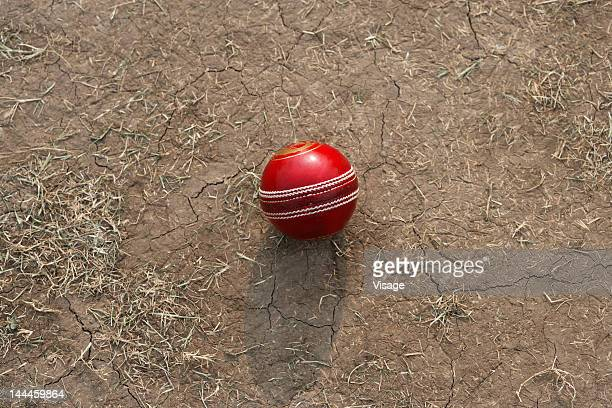 Top angle view of a cricket ball on the pitch