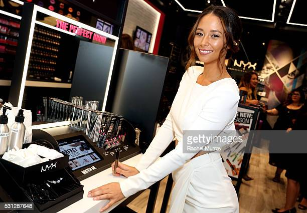 Top Beauty Influencer Aja Dang @ajadang at the NYX Beauty Bar during the NYX Professional makeup store grand opening ribbon cutting celebration at...