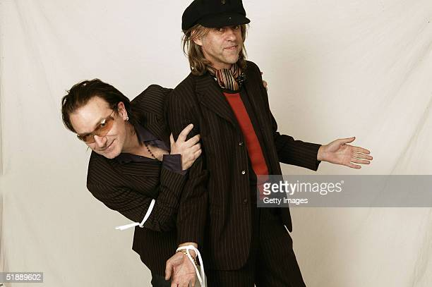Top British musical artists Bono and Sir Bob Geldof pose in a studio at the recording of the 20th anniversary remake of Midge Ure and Sir Bob...