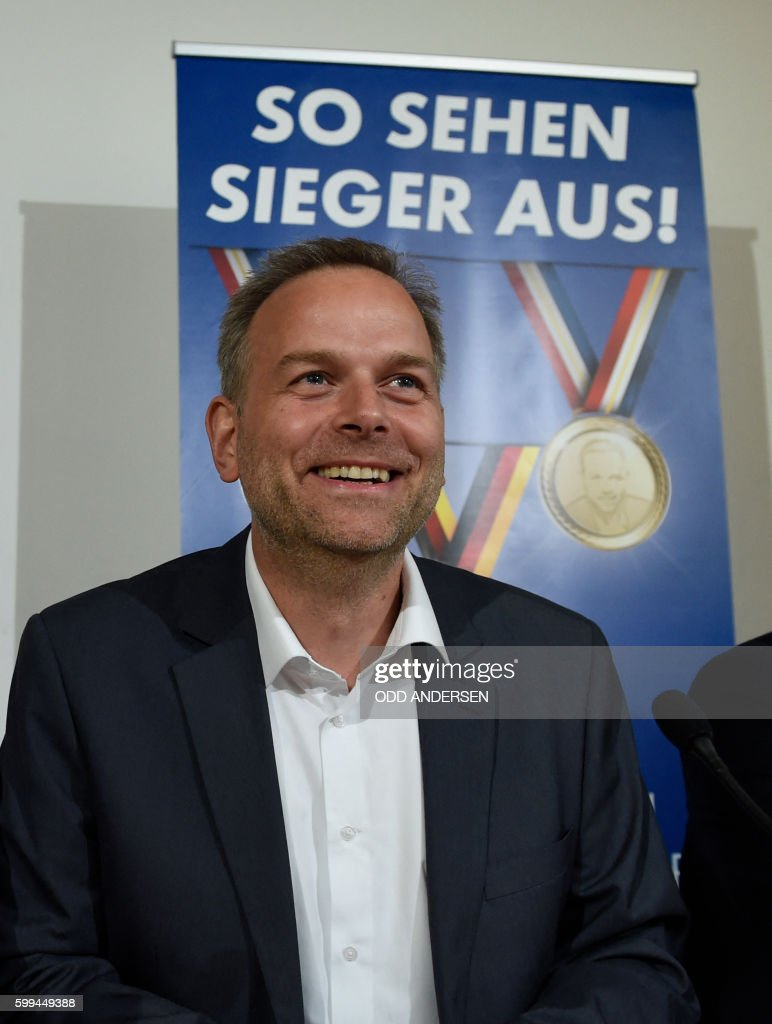 Top candidate for the AFD in Mecklenburg-Western Vorpommern Leif-Erik Holm attends a press conference in Berlin, on September 5, 2016 on day after the regional state elections in Mecklenburg-Western Vorpommern. The right-wing populist Alternative for Germany (AfD) party clinched almost 21 percent in its first bid for seats in the regional parliament of Mecklenburg-Western Pomerania. / AFP / ODD