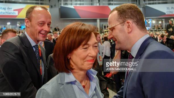 Top candidate for the CDU party's leadership and former CDU parliamentary group leader Friedrich Merz and his wife Charlotte greet German Health...