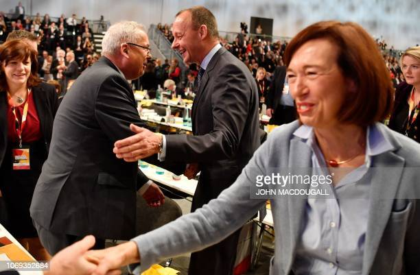 Top candidate for the CDU party's leadership and former CDU parliamentary group leader Friedrich Merz and his wife Charlotte greet delegates as they...