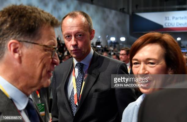 Top candidate for the CDU party's leadership and former CDU parliamentary group leader Friedrich Merz and his wife Charlotte arrive at the start of a...