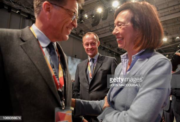 Top candidate for the CDU party's leadership and former CDU parliamentary group leader Friedrich Merz and his wife Charlotte greet a delegate se they...