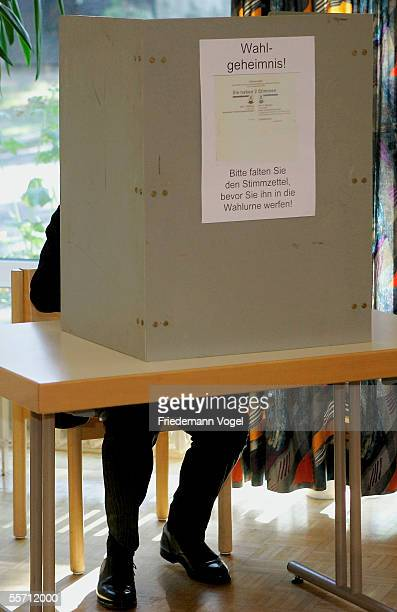 FDP top candidate Guido Westerwelle marks his vote in a voting booth on September 18 2005 in Bonn Germany 62 million Germans are eligible to elect...
