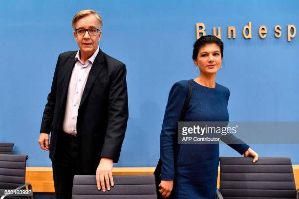 Top candidate of Die Linke party Sahra Wagenknecht and Dietmar Bartsch arrive at a press conference in Berlin on September 25 one day after general...