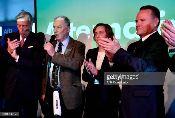 Top candidate of the Alternative for Germany Alexander Gauland speaks as exit poll results were broadcasted on public television next to Member of...