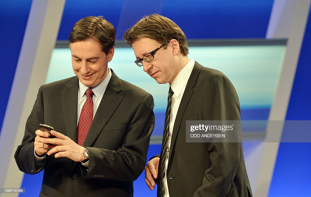 Top candidate of the Free Liberals, FDP, Stefan Birkner (R) and State premier of Lower Saxony David McAllister speak in a TV studio at the Landtag regional parliament in Hanover on January 20, 2013...