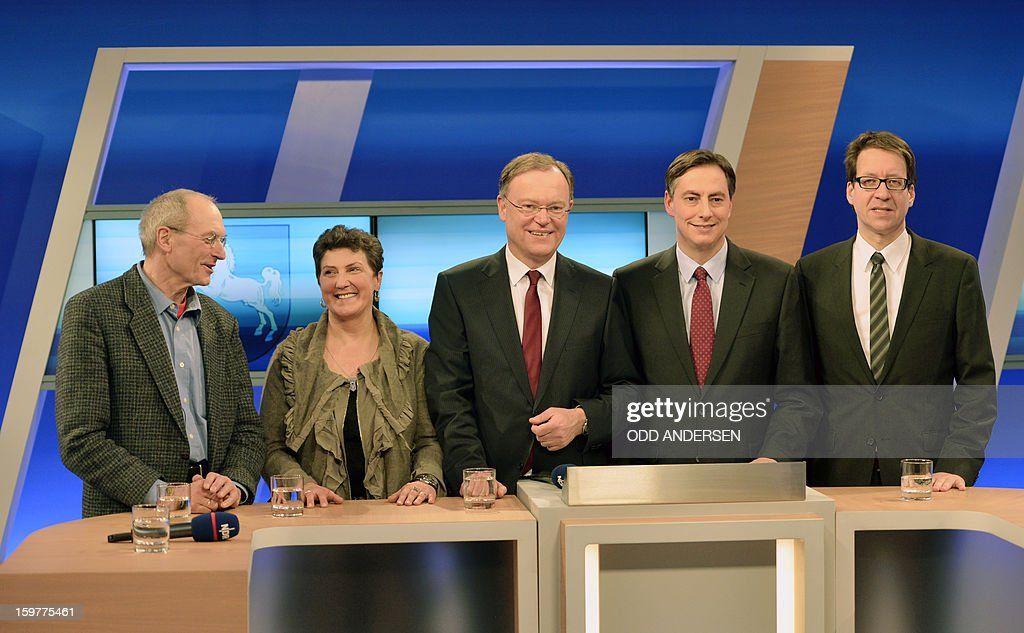 Top candidate of the Left Party Manfred Sohn, top candidate of the Greens Anja Piel, top candidate of the Social Democrats, SPD, Stephan Weil, State premier of Lower Saxony David McAllister and top candidate of the Free Liberals, FDP, Stefan Birkner pose in a TV studio at the Landtag regional parliament in Hanover on January 20, 2013 on polling day of the local elections in the central German state of Lower Saxony. The vote is largely seen as a test run for Chancellor Angela Merkel, her rivals and would-be heirs, eight months before nationwide polls. German Chancellor Angela Merkel's party was ahead after the first state poll in a general election year, exit polls indicated, but it was unclear whether its coalition would cling to power.