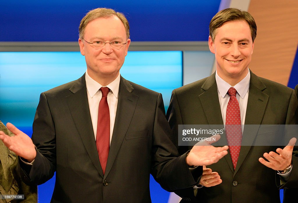 Top candidate of the Social Democrats, SPD, Stephan Weil (L) and State premier of Lower Saxony David McAllister pose in a TV studio at the Landtag regional parliament in Hanover on January 20, 2013 on polling day of the local elections in the central German state of Lower Saxony. The vote is largely seen as a test run for Chancellor Angela Merkel, her rivals and would-be heirs, eight months before nationwide polls. German Chancellor Angela Merkel's party was ahead after the first state poll in a general election year, exit polls indicated, but it was unclear whether its coalition would cling to power.