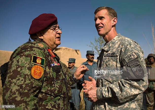 S top commander in Afghanistan Gen Stanley McCrystal talks to Afghan defense minster Abdul Rahim Wardak March 7 2010 in the southern province of...