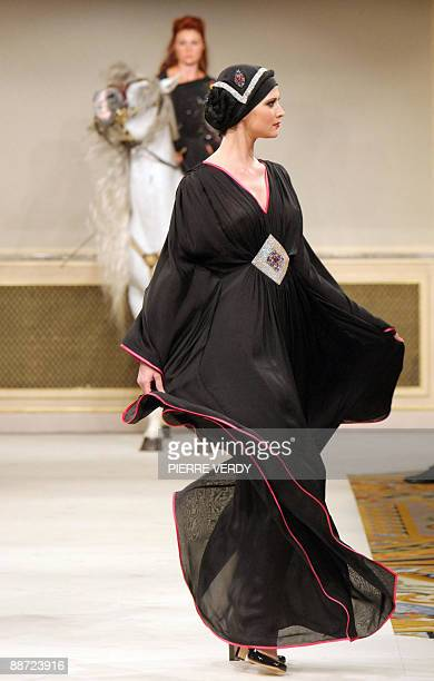'Top Designers try a revamp of Islamic abaya' A model presents a creation of abaya the traditional long black islamic overgarment by international...