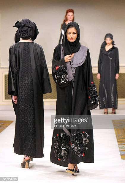 'Top Designers try a revamp of Islamic abaya' Models present creations of abaya the traditional long black islamic overgarment by international...