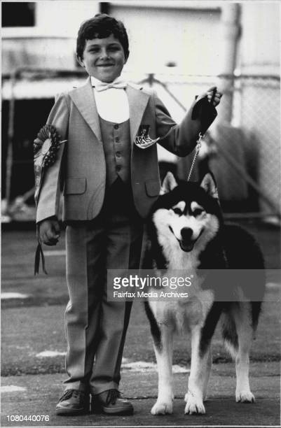 Jacob Holmes aged 8 with Gremlin a Siberian Husky at last year's Easter Show April 05 1988