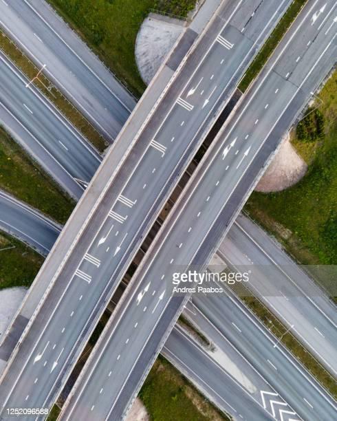 top down aerial view of highway overpass - estonia fotografías e imágenes de stock