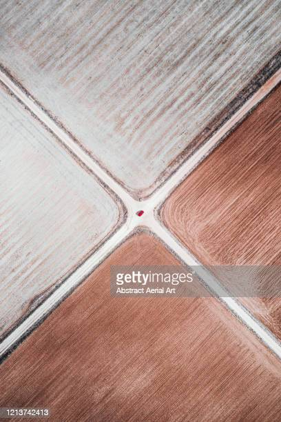 top down aerial view of two dirt roads crossing spanish farmland, spain - nature alphabet letters stock pictures, royalty-free photos & images