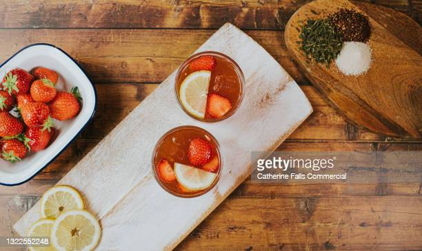 top down image of cocktails on a chopping board - cocktail party stock pictures, royalty-free photos & images