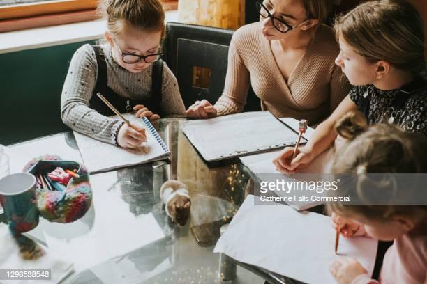 Top Down Image of Mother Homeschooling her Children