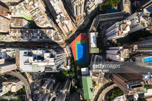 top down view of a sport ground in the very densely populated sai ying pun district in hong kong island - football pitch stock pictures, royalty-free photos & images