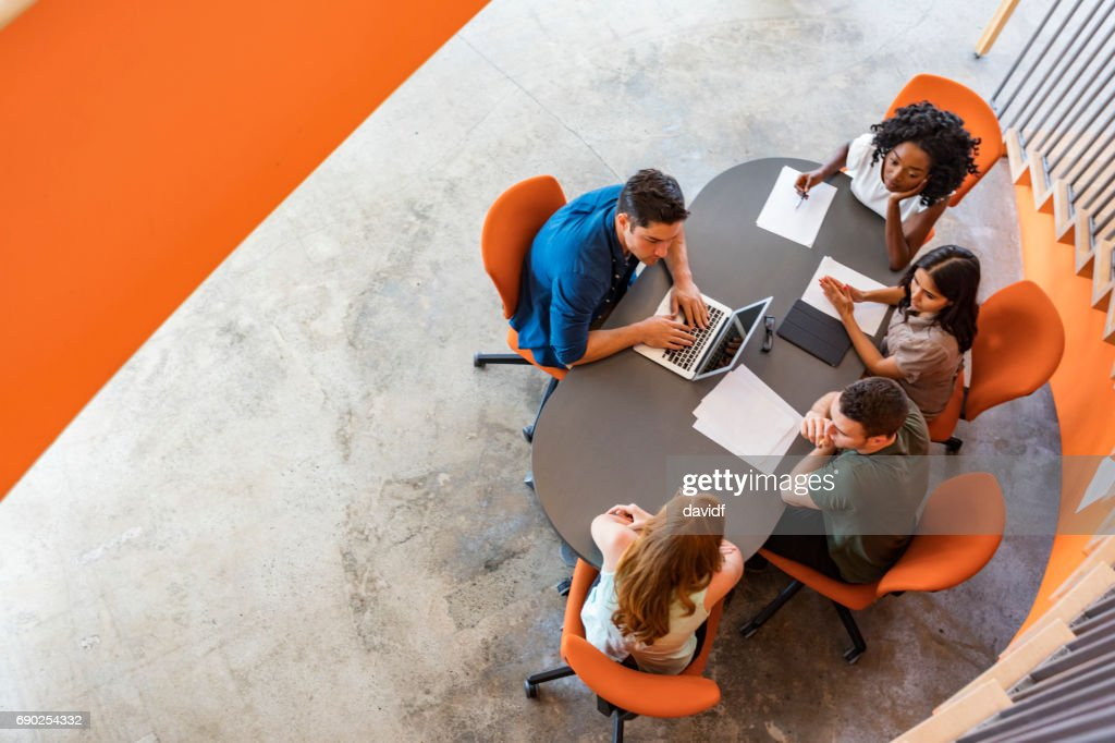 Top Down View of Open Plan Business Meeting : Stock Photo