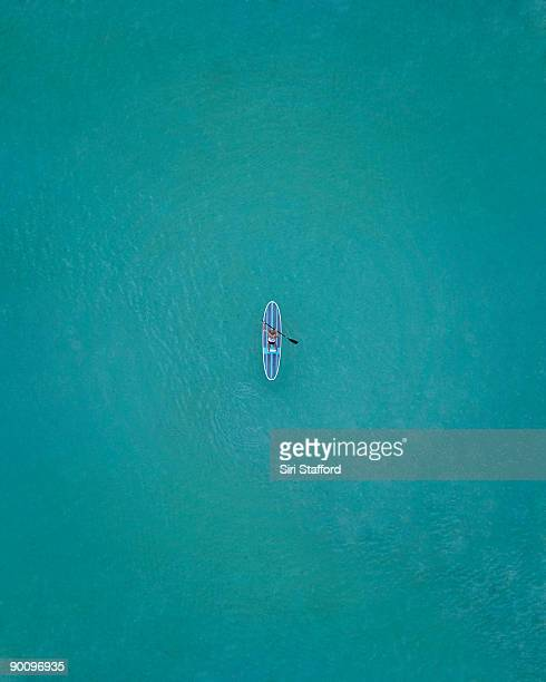 Top down view of paddle boarder in water