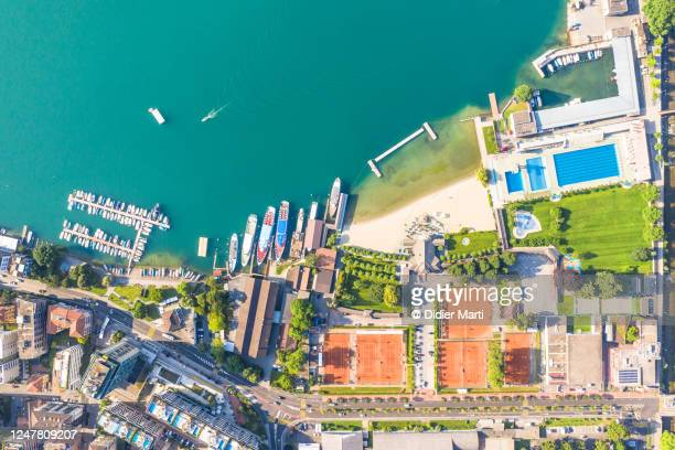 top down view of the lakefront leisure area of lugano in canton ticino largest city in switzerland - seeufer stock-fotos und bilder