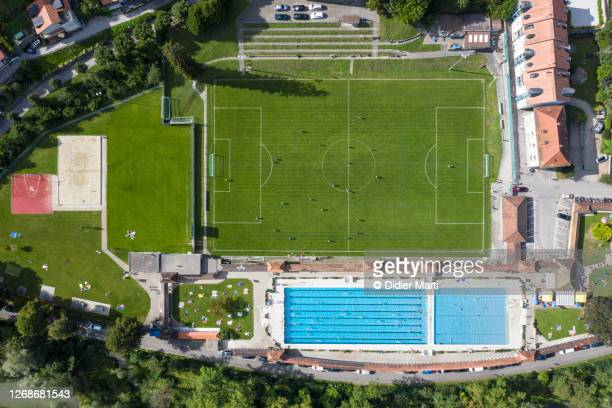 top down view of the motta swimming pool and football field in fribourg, switzerland - football pitch stock pictures, royalty-free photos & images