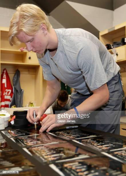 Top draft prospect Rasmus Dahlin signs autographs in the locker room prior to the Top Prospects Youth Hockey Clinic at the Dr Pepper StarCenter as...
