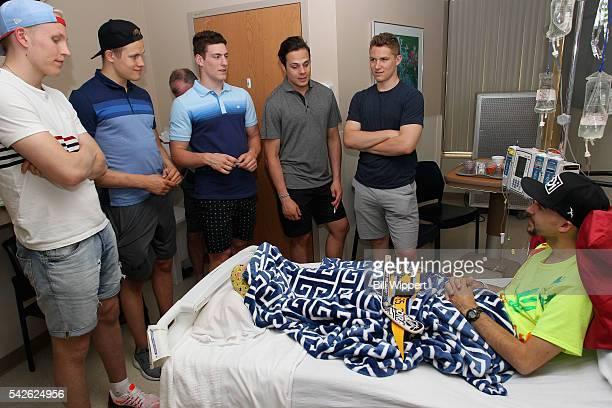 NHL top draft prospects Patrik Laine Jesse Puljujarvi PierreLuc Dubois Matthew Tkachuk and Auston Matthews talk with patient Jackson during a visit...