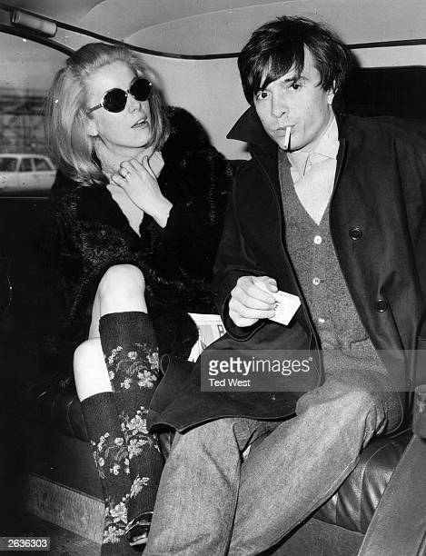 Top fashion photographer David Bailey and his wife French actress Catherine Deneuve in a car after their arrival in London where she was to attend...