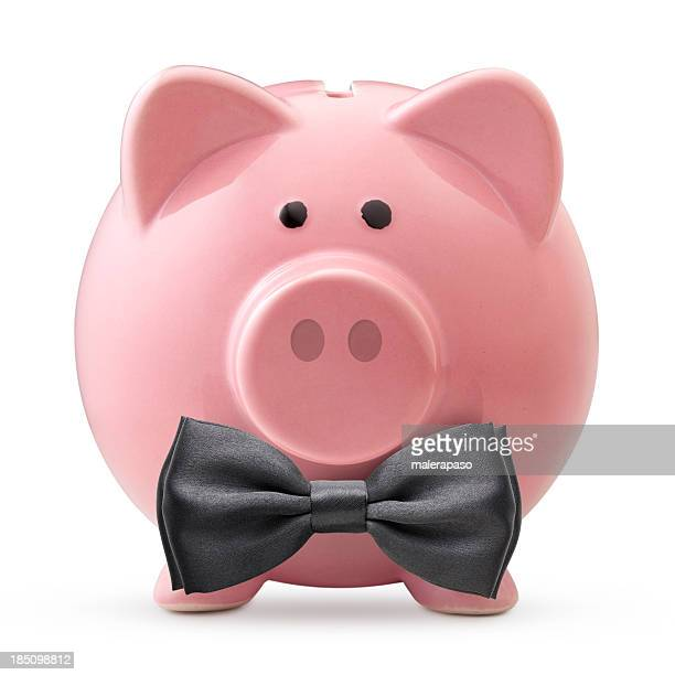 Top financial. Piggy bank with black bow tie.