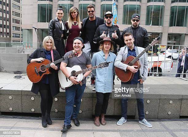 Top Four Finalists Ellie Drennan Liam MaihiNathan Hawes and Joe Moore stand in front of judges Jessie J Delta Goodrem Ricky Martin Joel Madden and...