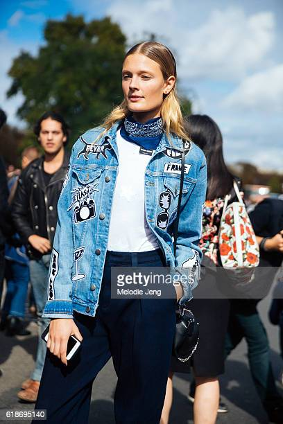 Top French model Constance Jablonski wears a Frame denim fashion week patchwork denim jacket a blue bandana around her neck a white top and blue...
