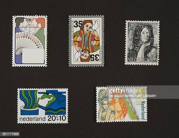 Top from left postage stamp honouring the World team Olympiad depicting Players at the table and deck of cards postage stamp depicting a Playing card...