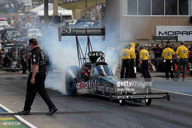 Top Fuel drag racer Antron Brown during his burnout on the second day of qualifying for the Mopar Parts Mile High Nationals at Bandimere Speedway...