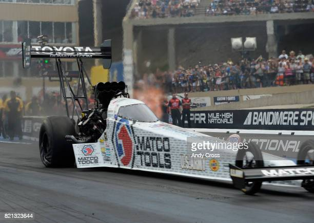 NHRA top fuel driver Antron Brown launches off the start line on his way to victory over Leah Pritchett for the top fuel final win at the 38th annual...