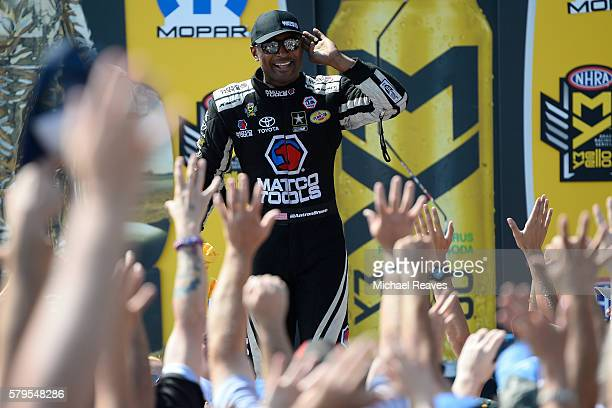 Top Fuel driver Antron Brown stirs up the crowd during day three of the NHRA Mile High Nationals at Bandimere Speedway on July 24 2016
