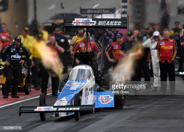 Top fuel driver Brittany Force launches off the start line during qualifying at the Dodge Mile-High NHRA Nationals at Bandimere Speedway July 20,...