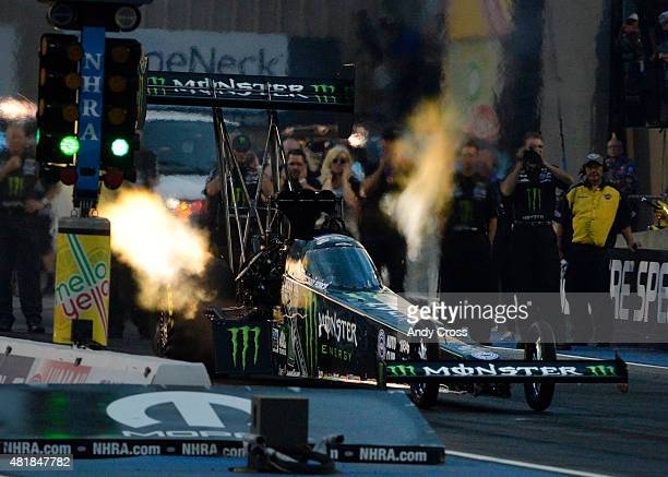 Top Fuel driver Brittany Force lights it up coming off the line and sets a new track record with a top speed of 32374 mph on her first qualifying run...